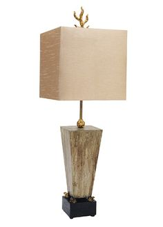 The whimsical Grenouille table lamp by Paul Grüer for Flambeau is anchored by a stately tapered base in a new umber-washed finish ($350).
