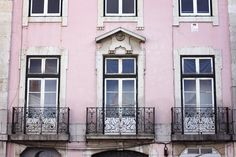 pink house facades and romantic balconies in Lisbon, Portugal - teetharejade.com