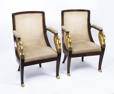 This is a beautiful pair of hand carved and gilded solid mahogany  French Empire armchairs C 1820 in date.  They have beautifully carved and gilded swan neck decoration and front legs that terminate in decorative gilded paw feet.  They are beautifully upholstered, really comfortable, and are ready to grace your drawing room.  Add a touch of class to your home with this exceptional pair of armchairs.  Condition:  In excellent condition having been beautifully polished and upholstered in our…