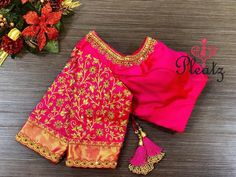 Gorgeous hot pink color designer blouse with floret lata design hand embroidery gold thread and bead work on neckline and sleeves. Blouse with pattu boarder on sleeves. Wedding Saree Blouse Designs, Pattu Saree Blouse Designs, Blouse Designs Silk, Designer Blouse Patterns, Half Saree Designs, Pink Blouse Design, Stylish Blouse Design, Hand Work Blouse Design, Magam Work Blouses