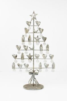 DetailsDisplay your favorite cards and memories this season with this rustic metal tree. With its aged texture and star, heart, bird, and candle details, this unique card display will surely be a welcome staple of your Holiday x x Christmas Tree Cards, Christmas Card Holders, Metal Tree, Unique Cards, Candles, Display, Rustic, Grey, Holiday