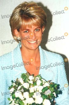 21 April 1997: Diana, Princess of Wales presented with the 1st Rose to be named after her at the British Lung Foundation Offices in London. Alpha/Globe Photos,inc
