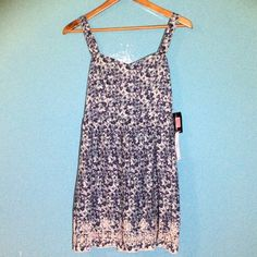 NWT Tweeze Me Sundress with pretty hem detail NWT Tweeze Me Sundress with pretty hem detail   Colors are beautiful blues and greens. Skirt length approximately 19 inches. Tweeze Me Dresses