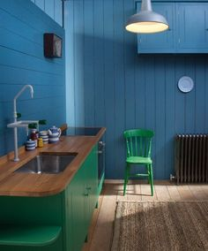 Deep blue kitchen walls!  Eclectic Kitchen by British Standard by Plain English