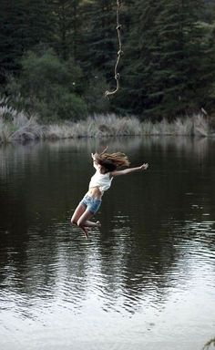 summer fun...jump into a lake on a rope, randomly