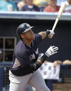 New York Yankees' Yangervis Solarte flies out off a pitch by Tampa Bay Rays' Cesar Ramos in the first inning of an exhibition baseball game, Wednesday, March 5, 2014, in Port Charlotte, Fla. (AP Photo/Steven Senne)