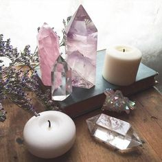 Lovely pink and purple altar with crystals and candles. We have a large selection of crystals to choose from. Come and create your own shrine. Will bring peace and harmony into the house. 11/09