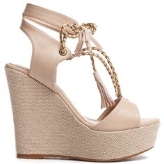 Nude lace up platform with textile wedge and decorative tassels. Fastens with laces.
