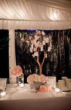 """Involve guests at your reception by asking them to write down marriage advice on paper (""""post-it' sized) and have them hang it on your Wishing well tree :)"""