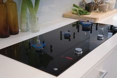 CookSurface from Fisher & Paykel Appliances features gas-in-glass cooktop technology with retractable burners and pan supports