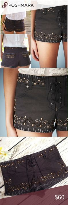 Kate Moss for Topshop Studded Denim Shorts NWT Brand new with tags black denim shorts with stud embellishments, lace up front, and intricate pocket detailing by Kate Moss for Topshop.   US size 2.  98% cotton, 2% elastane Topshop Shorts Jean Shorts