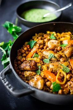 Tunisian Chicken ( or chickpeas) with Carrots, Cous Cous and Green Harissa Yogurt Sauce - A one-pot meal that can be made in 45 mins.