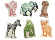 """Animal """"print"""" pillows.  Love the zebra and the elephant!"""