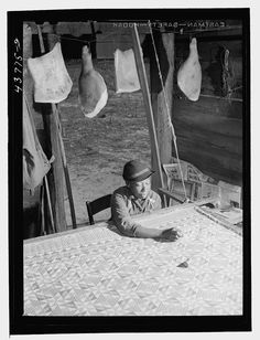 One of my favorite quilting photos: quilter working in a smokehouse, Georgia 1944. Library of Congress collection.