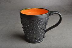 Spiky Mug: Made To Order Black and Orange Dangerously Spiky Mug by Symmetrical Pottery from symmetricalpottery on Etsy. Saved to 50 Shades of Orange.