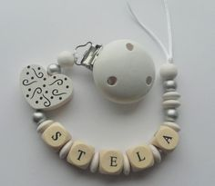 Wooden beaded pacifier clip personalised by Toysforchildren