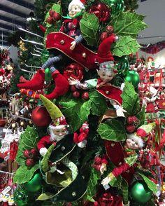Having fun, decorating with elves. #elves #christmaselves #visualmerchandising #redandgreen #christmas