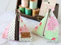 Here's a great use for those little scraps of fabric. Make this adorable triangle pouch to stash your loose change, make-up or other goodies.