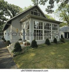 SUNROOMS: Front of small grey stucco bungalow, addition of sunroom, border garden along house with shrubs and flowers, View Large Photo Image House With Porch, House Front, Porch Kits, Porch Ideas, Sunroom Addition, Enclosed Porches, Screened Porches, Building A Porch, Building Plans