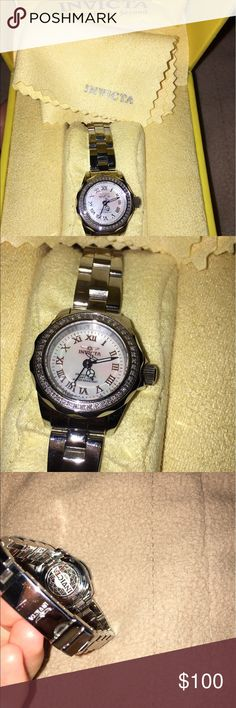 Invicta Woman silver pro diver mini watch Invicta Woman Mini Pro Diver Silver watch  •retail price $125.00 •invicta product number 12525 • New with tags. Plastic and tags visible in picture  •24 mm  •Water resistant  •Band size 10 mm to 12 mm widest when band open •LxWxH 24mm x 10mm •No free shipping •willing to negotiate price Invicta Accessories Watches