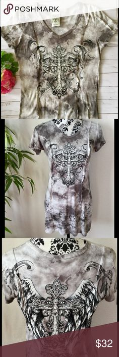 """New condition Vocal long rhinestone cross rib tee. Beautiful rhinestone encrusted cross graphic on front & rhinestone cross with wings graphic on back. Mottled gray quality ribbed cotton with raw edged seams running down the front and back. Measurements laying flat: armpit to armpit 17"""" stretching up to 21"""". Long enough to be worn as a mini dress depending on your height. Length from the shoulder to hem 30"""". New condition, I don't think I ever wore it and it's way too nice to just hang in my…"""