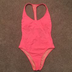 Bathing Suit Beautiful coral colored one piece bathing suit. Brand new, never worn!! Hygienic liner still attached & original bag it came in included!  **Final Sale** Victoria's Secret Swim One Pieces