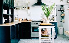 Black and white kitchen with pantry area packed with storage solutions. Via: @ichliebedeko