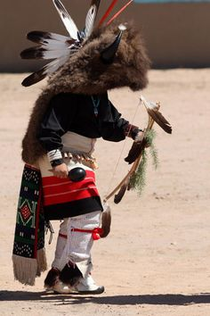 Remembering the Pueblo Revolt of 1680. A young Tesuque Pueblo boy performs the traditional buffalo dance in the Pueblo's plaza, as his ancestors have done for centuries. Photo: M. A. Pember