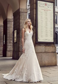 Sheer illusion netting on the sides will enhance your silhouette in this lovely A-line gown.