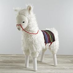 Larry the Llama is extra fuzzy and soft, plus he's sturdy enough for your little ones. Not only that, he also comes with a colorful blanket and reign. Designed exclusively for us by Sabina Gibson. Nod exclusiveA Sabina Gibson designMeasures over 2 feet tall and includes a colorful blanket and reinShow 'em what you're made ofSolid wood frame and legsPolyester with polyfillCare instructionsSpot cleanAge range3 and up Max weight: 70 lb. or less.