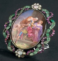Silver brooch decorated with a miniature enamel representative Aeneas and Anchises after Coypel, surrounded by colored stones and pearls. (gaps, small accidents). Eighteenth century.