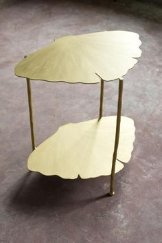 vanCollier   Susanne Tiered Ginkgo Table   Crafted out of steel and hand-painted with a gilded finish, this organically-shaped side table from the Ginkgo Collection is inspired by the leaves of the tree. A broad fan-shaped leaf serves as the top and bottom of the table with three hammered steel legs. Measures approximately 22″ wide x 16″deep x 24″ tall. Custom finishes available. #HPmkt