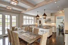 Gorgeous Crown Point kitchen with white washed beams in Cove Hollow Barn Home by Yankee @barnhomes #custom
