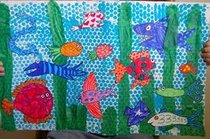 Under Sea collage with bubble wrap printed background, tissue paper seaweed, and cut out sea creatures.