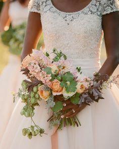 A gorgeous, wild bouquet    Photography: Cat Mayer Studio - www.catmayerstudio.com  Read More: http://www.stylemepretty.com/2015/01/15/rustic-farm-to-table-wedding-inspiration/