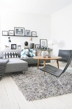 Nordic inspired living room kept in black and white as a base with blue and grey nuances.