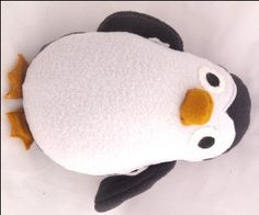 Plushie Penguin (instead of plain fleece, try stain-friendly fabric with pattern and chewable feet for infant)