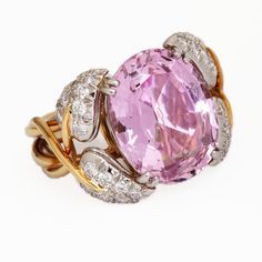 This exquisitely designed Schlumberger for Tiffany & Co. ring is set with a large bright pink topaz that weighs approximately 10 carats, mounted in four petals of diamonds and platinum with gold stems winding down to create the band. Tiffany And Co Jewelry, I Love Jewelry, Silver Jewelry, Vintage Jewelry, Jewelry Design, Jewelry Box, Jewlery, Fine Jewelry, Pink Topaz Ring