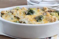 Skinny Chicken & Broccoli Casserole - This healthy casserole is filled with chicken, broccoli and mushrooms in a light & creamy sauce. Your family will love it!