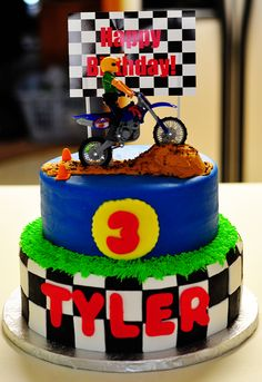 """3rd Birthday Dirtbike Cake - White cake with buttercream covered with MMF. MMF accents. The only thing not edible is the dirt bike and the """"billboard"""" sign. Thanks for looking!"""