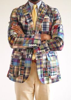 Madras jacket, white shirt with light blue candy stripes, yellow knit tie, khakis