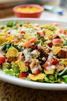 Chicken Taco Salad: YUMMY!!! I used this recipe as a basic idea. Without doing any measuring I added each ingredient on the list in addition to some taco seasoning that I tossed in with the grated cheese before I included it. I subbed Monterey Jack for the pepper jack (because that all I had) and used chicken that I already had made. This is a goody!! ~n~