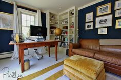 Coastal chic navy blue office with painted white plywood floors