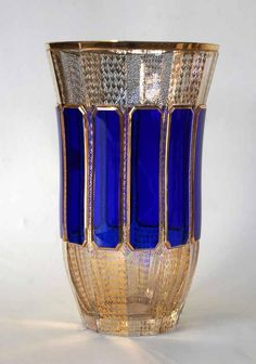 A large Moser vase in clear glass, c.1930's with gilded decoration and raised ultra marine blue, coloured glass panels.