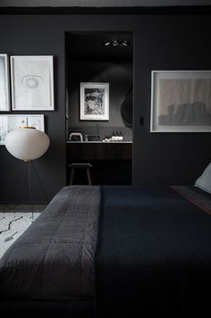 A dark, dramatic room of charcoal greys and deep blue from Romain Ricard.