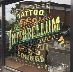 The Interbellum Tattoo Lounge signwriting and gold leaf by Paul Banks Signs. Painted Letters, Hand Painted Signs, Tattoo Lounge, Gold Leaf Art, Tattoo Signs, 2 Logo, Window Signs, Sign Writing, Studios