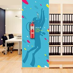 AVDS for Environmental Graphics and Workplace Branding: When the brand talks a unique language just because it can, it opens up a big door to explore the creative expression. Kult, Simply Inspire created by AVDS takes the vocabulary of the brand to the fire extinguishers in the office.. . . . . . #kult #kultimpulse #officeinteriors #officebranding #environmentalgraphics #graphicdesign #wallgraphics #fireextinguisher #simplyinspire Office Wall Design, Office Mural, Office Wall Decor, Office Walls, Office Interior Design, Office Interiors, Environmental Graphic Design, Environmental Graphics, Office Branding