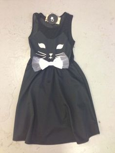 hmmmm this might be an easy h'ween idea if you've got a cute little black dress and some white felt....