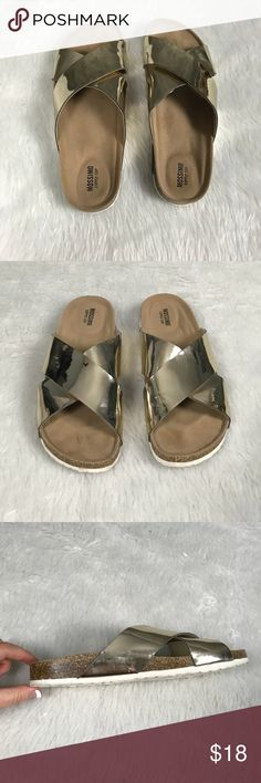 """💥Mossimo Metallic gold criss-cross sandals Mossimo gold metallic criss-cross sandals •Shiny gold straps •These will go with just about anything •Really comfortable! •Barely worn- excellent condition! •No size listed on shoe but are a size 8 •Total length: 10.5"""" •Size 8  👣 Check out more sandals in my closet 👣 ⚜️ Same/next day ship ⚜️ 🐲 Smoke-free 🐲  I do not discuss price in the comments Mossimo Supply Co. Shoes Sandals"""