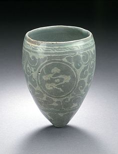 Korea  Equestrian Cup (Masangbae) with Clouds and Chrysanthemum Sprays, Goryeo dynasty, 918-1392, 12th century  Ceramic, stoneware, Wheel-thrown stoneware with incised and slip-filled decoration and green glaze,